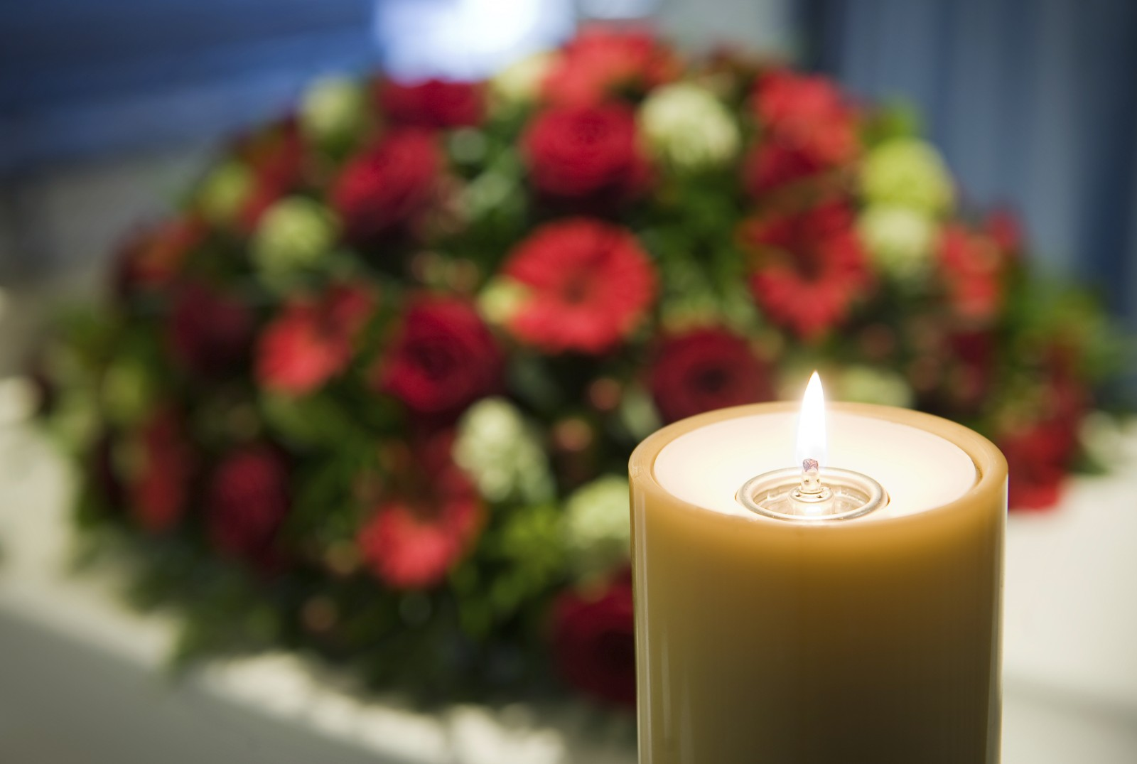 istock-candle-flower-funeral-e1457724228315